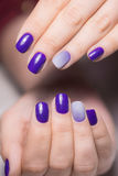 Beautiful female hands with bright manicure. Nails covered with nail Stock Photo