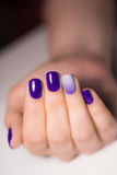 Beautiful female hands with bright manicure. Nails covered with nail Stock Photography