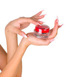 Beautiful female  hands with the cosmetic product Royalty Free Stock Photo