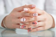 Beautiful female hands with a fashionable manicure. Geometric design of nails. Photo closeup stock images