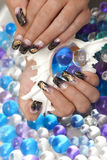 Beautiful female hands with nail art manicure. Royalty Free Stock Image