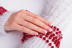 Beautiful female hands with New Year's manicure. Royalty Free Stock Image
