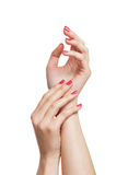 Beautiful female hands with pink manicure on white Stock Photos