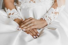 Beautiful female hands with the wedding ring and elegant manicure. A symbol of love stock image