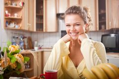 Beautiful female having a breakfast Royalty Free Stock Photography