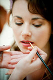 Beautiful Female Having Her Make Up Done By A Make Up Artist Stock Image
