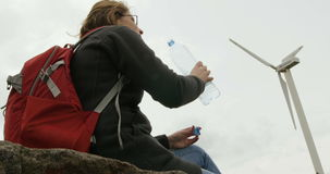 Beautiful female hiker drinking purified water stock video