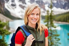 Beautiful female hiker smiling. Portrait of happy beautiful female hiker smiling stock image