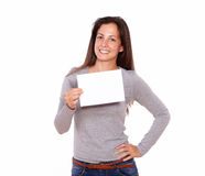 Beautiful female holding card smiling at you Royalty Free Stock Image