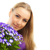 Beautiful female holding flowers Stock Images