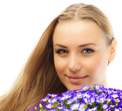 Beautiful female holding flowers Royalty Free Stock Photos