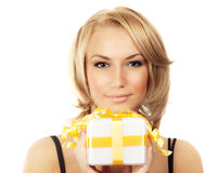 Beautiful female holding gift box Royalty Free Stock Images