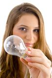 Beautiful female holding light bulb. Against white background Royalty Free Stock Photo