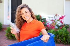 Beautiful female holding recycling bin Stock Photos