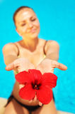 Beautiful female holding red flower Stock Photo