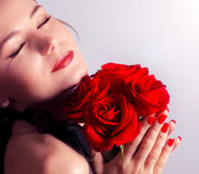 Beautiful female holding red roses bouquet Royalty Free Stock Image