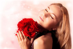 Beautiful female holding red roses bouquet Stock Photos