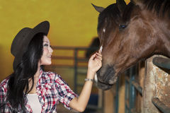 Beautiful female horse rider in ranch Royalty Free Stock Images
