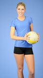 Beautiful female indoor volleyball player Stock Image