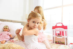 Beautiful female kids smartening in bedroom stock photography
