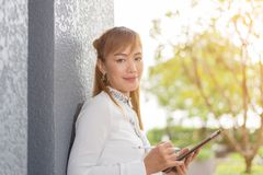 Asian businesswoman using tablet in office royalty free stock photos