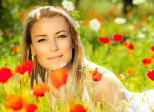 Beautiful female laying on the flower field Stock Photo