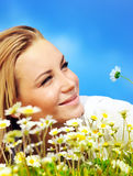 Beautiful female laying on the flower filed Royalty Free Stock Image