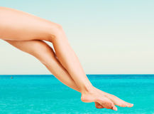 Beautiful female legs against sea Royalty Free Stock Photography