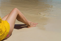 Beautiful female legs on the beach. Royalty Free Stock Photography