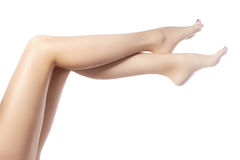 Beautiful female legs after depilation. Healthcare, foot care, rutine treatment. Spa and epilation. Sexy shape of woman's body. Part of female body. Feet with Stock Images