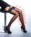 Beautiful female legs in erotic stockings with arrows Stock Photo