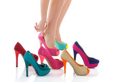Beautiful female legs in fashion shoes. Woman's long legs with high heels royalty free stock photo
