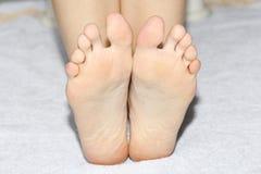 Beautiful female legs, heels, feet. Foot care, massage, spa. Heel care. stock photo
