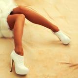 Beautiful female legs in high heels Stock Photos
