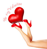 Beautiful female legs holding heart Royalty Free Stock Photo