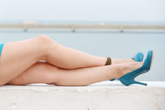 A beautiful female legs outdoors . Royalty Free Stock Image