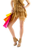 Beautiful female legs and paper bags in hand isolated Royalty Free Stock Photography