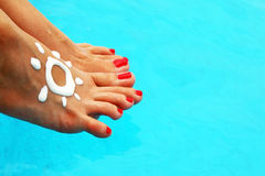 Beautiful female legs in the pool Royalty Free Stock Photography