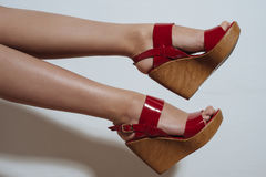 Beautiful female legs in red sandals on a wedge Royalty Free Stock Photos