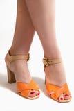 Beautiful female legs in sandals. Stock Image