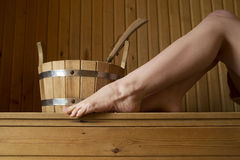Beautiful female legs in sauna, bath accessories Stock Photography