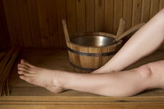 Beautiful female legs in sauna, bath accessories Royalty Free Stock Photo