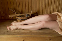 Beautiful female legs in sauna, bath accessories Stock Images