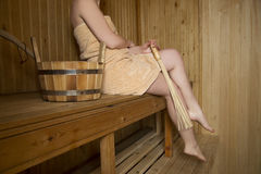 Beautiful female legs in sauna, bath accessories Royalty Free Stock Image