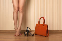 Beautiful female legs, shoes and bag Stock Photo
