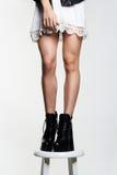 Beautiful female legs.short skirt.high heels Stock Photography