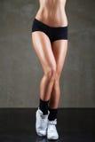 Beautiful female legs in sport wear Stock Photo