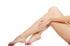 Beautiful female legs touched by hand Royalty Free Stock Image