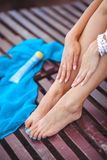 Beautiful female legs touched by hand Royalty Free Stock Images