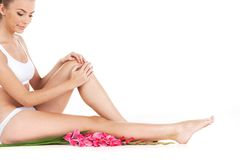 Beautiful female legs on white background. stock photography